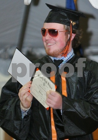 Beverly: Zachary Currier shows off his diploma after taking the stage during graduation ceremonies at Beverly High School on Sunday afternoon. The school graduated 286 students this year. Photo by Matthew Viglianti/Staff Photographer Sunday, June 14, 2009.
