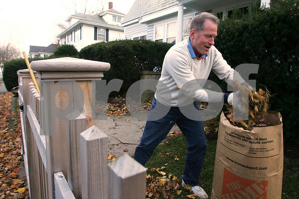 Beverly: Ed Bell of Beverly gathers fallen leaves from the front lawn of his Dane Street home on Monday afternoon. Photo by Matthew Viglianti/Staff Photographer Monday, November 17, 2008.