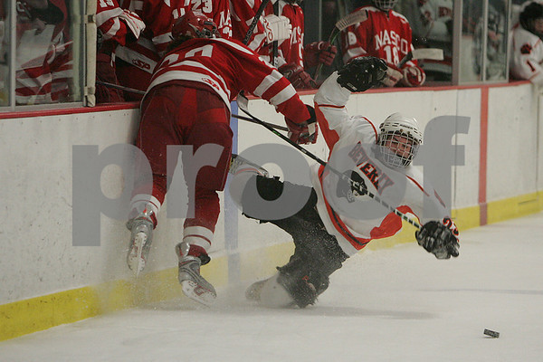Hamilton: Ryan Karp from Beverly, right, gets checked by Masconomet captain Keaton Cashin during the first period of a Tuesday night hockey game between the two teams in Hamilton. Photo by Matthew Viglianti/Staff Photographer Tuesday, December 23, 2008.