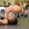 Hamilton: Adam Hammdorff from Hamilton-Wenham High School keeps an eye on the scorer's table while trying to pin Wakefield's Pat Stickney during a wrestling match between the two schools in Hamilton on Tuesday. Hammdorff outscored Stickney 16-0 to win the 152 pound weight class match. Photo by Matthew Viglianti/Staff Photographer Tuesday, December 23, 2008.