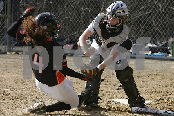 Peabody: Kaleigh Ryan from Peabody blocks the plate and tags out Jenn Gallinoe from Beverly during the top of the fouth inning at the Kiley School Field, where Peabody played Beverly on Thursday. Photo by Matthew Viglianti/Staff Photographer Thursday, April 9, 2009.