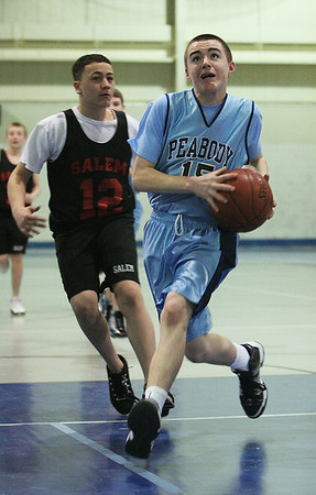 Peabody: Matt Hosman goes strong to the hoop during a basketball game against Salem at Peabody High on Saturday. Hosman and a number of his teammates on the Higgins School 7th grade basketball team were also stars on the Peabody West Little League baseball team that went to the Little League World Series last summer. Photo by Matthew Viglianti/Staff Photographer Saturday, January 23, 2010.