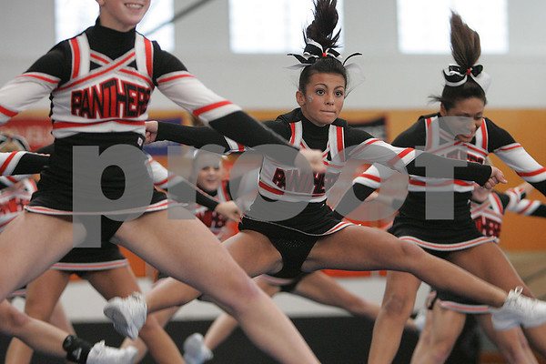 Beverly: Janelle Gomes, center, and the Beverly High School cheerleading squad focus on their exhibition performance at the annual Beverly Halloween Classic Cheerleading Competition at the high school on Sunday. Photo by Matt Viglianti/Salem News Sunday, October 26, 2008