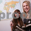 Salem: Shannon Cormier of Salem, left, and Chelsea Osborn of Gloucester have traveled the world wearing Converse All-Star shoes. They became friends while on a trip to Paris with the geography department at Salem State College, and are leaving for four months in South America in January. Photo by Matt Viglianti/Salem News Sunday, December 07, 2008