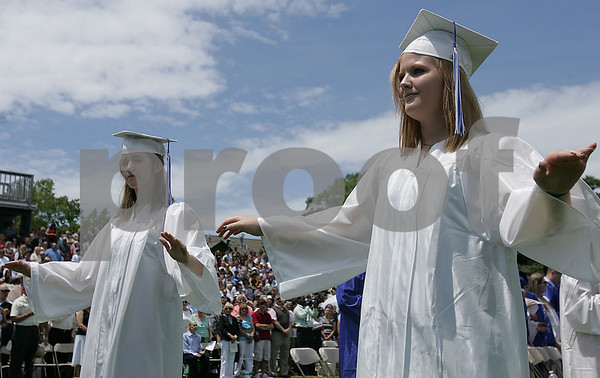 Swampscott: Emily Best, right, and Alix Dorgan, conduct the Swampscott High School band during the National Anthem at graduation ceremonies for the Swampscott High School class of 2009 at Blocksidge Field on Sunday. Photo by Matthew Viglianti/Staff Photographer Sunday, June 7, 2009.