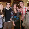 Saugus: From left to right, Paula Gonzalez and Nicolas Tejera from Argentina, Anamarie Venegas from Columbia, and Gustavo Espinoza and Federica Garcia from Mexico enjoy the festivities at Prince Pizza, where a group of North Shore au pairs from around the world gathered for a holiday party on Wednesday night. Photo by Matthew Viglianti/Staff Photographer Wednesday, December 16, 2009.