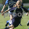 Danvers: Sarah Hingston carries the ball for the Swampscott U-12 Blue Lightning during their game against the Georgetown U-12 Blue Storm in the 2009 Danvers Invitational Tournament at Danvers High School on Monday. The 18th annual tournament hosted over 180 teams. Swampscott won their game 2-0 to advance to the next round. Photo by Matthew Viglianti/Staff Photographer Monday, May 25, 2009.