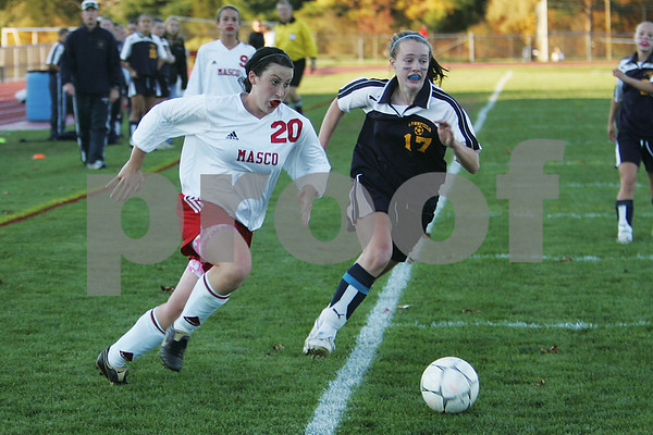 Topsfield: Masconomet senior captain Cara Connors, left, cuts towards the goal as Lynnfield freshman Lauren Mccarthy gives chase during the second half of Masco's 5-2 win over Lynnfield in Topsfield on Monday. Photo by Matt Viglianti/Salem News Monday, October 20, 2008