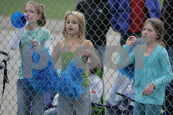 "Beverly: From left, Sarah Welsh, 10, Marlee Hamor, 8, and Nicole Welsh, 8, all from Beverly, cheer on their mother's during the championship game of the ninth annual ""Momball"" softball tournament in Beverly on Sunday. The girls' moms played for the Cove School team, which competed against the mothers from the St. Mary's Star of the Sea School team for the title. Photo by Matt Viglianti/Salem News Sunday, October 05, 2008"