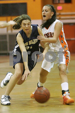 Beverly: Swampscott junior Kara Gilberg, left, makes an aggressive move with the ball against Beverly captain Kellie Shea during the second quarter of the Big Blue's away game against Beverly on Tuesday. Photo by Matt Viglianti/Salem News Tuesday, January 27, 2009