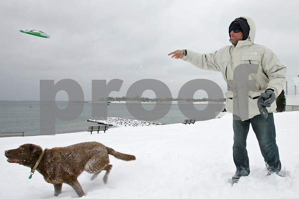 Beverly: Tim O'Leary of Beverly tosses a Frisbee for his dog, Bruce, a two-year-old Chesapeake Bay Retriever, at Independence Park in Beverly on Monday afternoon. Photo by Matthew Vigliati/Staff Photographer Monday, March 2, 2009.