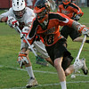 Marblehead: Brendan Crowley from Beverly, right, loses the ball after a check from Marblehead's Adam Nassaf during their team's game in Marblehead on Wednesday. Beverly won the game 8-6 to win the NEC championship. Photo by Matthew Viglianti/Staff Photographer Wednesday, May 26, 2010.