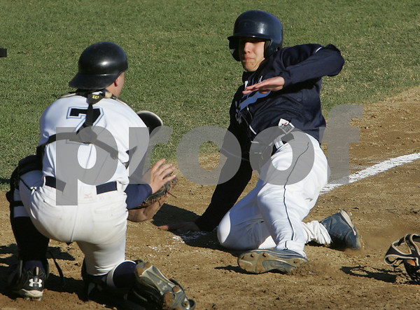 Peabody: Peabody catcher Brian Latorella blocks the plate as Rob Atkin from St. John's Prep tries to score from third on a fielder's choice during the sixth inning of their teams' game at Peabody on Monday afternoon. Atkin was called out on the play, but the Eagles won the game 6-2 to improve to 4-0 on the season. Photo by Matthew Viglianti/Staff Photographer Monday, April 13, 2009.