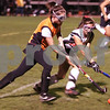 Salem: Salem senior Kerrie Vasquez, right, shadows Beverly senior captain Meg Finn as Finn takes the ball upfield for the Panthers during their game at Salem on Thursday. The teams tied 2-2. Photo by Matt Viglianti/Salem News Thursday, October 23, 2008