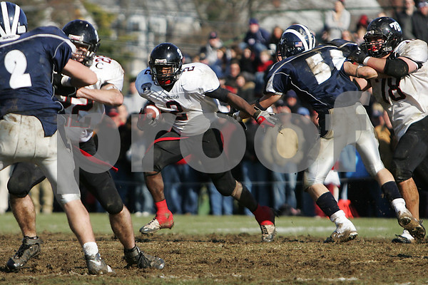 Swampscott: Marblehead senior running back Brandon Lee cuts through a tackle with help from a block by sophomore lineman Ben Koopman (78) on Swampscott senior Ryan Mihovan (55) during the 100th game between the teams on Thanksgiving Day in Swampscott on Thursday. Swampscott won the game 21-13 to take the Northeastern Conference Small championship. At left, Marblehead senior captain Dan Comeau (22) works to free Lee with a block on Swampscott junior Randall Kelleher (2). Photo by Matthew Viglianti/Staff Photographer Thursday, November 27, 2008.