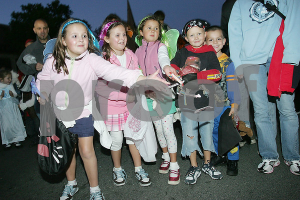Salem: A group of girls throws candy to parade watchers during the Haunted Happenings Parade in Salem on Thursday. Photo by Matt Viglianti/Salem News Thursday, October 02, 2008