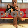 Marblehead: Kate Luchini of Marblehead sits on her Mid Century Modern sofa with her sons Luca Sherwood, 5, left, and Nico Sherwood, 2, on Monday afternoon. Luchini owns several pieces of Mid Century Modern furniture, and the style is at a new high of popularity. Photo by Matt Viglianti/Salem News Monday, September 08, 2008