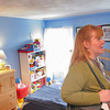 Salem: Kristina Borys from Salem looks through an upstairs bedroom at 12 Williams Street in Salem during an open house event organized by the Salem Chamber of Commerce and Salem Main Streets on Sunday. Borys has been renting an apartment on Essex Street in Salem for 20 years, and decided it was time to move with her two children when her daughter graduated from Salem High School last year. Photo by Matthew Viglianti/Staff Photographer Sunday, June 14, 2009.
