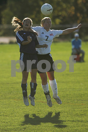 Beverly: Swampscott sophomore Lisa Gambale, left, leaps for a header against Beverly sophomore Monica Cassola during the first half of Swampscott's game at Beverly on Tuesday. Swampscott won the game 5-2. Photo by Matt Viglianti/Salem News Tuesday, October 07, 2008
