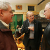 Peabody: Bill Toomey, center, speaks with Steve Smidt, right, and Richard Herman at the Peabody Leather Workers Museum open house on Thursday evening. All three men share a connection to the Peabody leather industry. Toomey began working in the industry after graduating Peabody High School in 1950. Herman owned Herman's Boot Shop in Peabody Square, and Smidt once owned a business called S.C. Smidt Leather Corp. Photo by Matthew Viglianti/Staff Photographer Thursday, November 19, 2009.