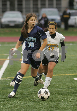 Peabody: Emily Manoogian from Peabody turns the ball upfield for the Tanners while being shadowed by Bishop Fenwick's Kristin Verrette during the first half of their teams' game at Fenwick on Monday. The game ended in a 2-2. tie. Photo by Matt Viglianti/Salem News Monday, November 03, 2008