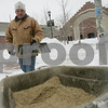 Salem: Bill Naylor of Beverly returns to a wheelbarrow to pick up a shovel-full of sand while working for a Salem company to maintain the sidewalks around the former armory building on Monday afternoon. Naylor and his crew started working to clear the storm-dumped snow at 5 a.m.. Photo by Matthew Viglianti/Staff Photographer Monday, March 2, 2009.