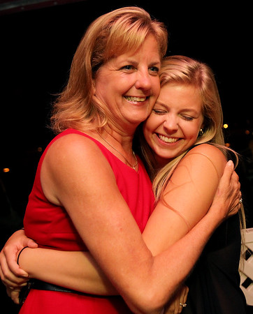 Democratic Nominee for State Senate Joan Lovely gets a hug from her daughter Taylor, right, as she arrived at the Moose Club in Salem after winning the primaries on Thursday evening. David Le/Staff Photo