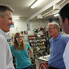 Senator Scott Brown, left, talks with Hannah Darrah, 20, Richard Darrah, owner of Browns of Beverly Bicycle Shop and Congressional candidate Richard Tisei on a visit to Beverly on Friday afternoon. David Le/Staff Photo
