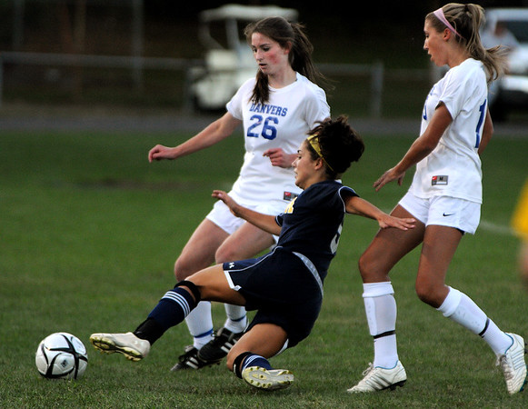 Danvers:<br /> Andover's Lily Puccia stretches for the ball as it goes out of bounds as Danvers' Jackie Morse, left, and Danvers' Delaney Zecha, right, cover her during the Andover at Danvers girls soccer game at Deering Stadium.<br /> Photo by Ken Yuszkus/The Salem News, Monday, September 10, 2012.
