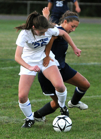Danvers:<br /> Danvers' Jackie Morse, left, fights over the ball with Andover's Devon Caveney during the Andover at Danvers girls soccer game at Deering Stadium.<br /> Photo by Ken Yuszkus/The Salem News, Monday, September 10, 2012.