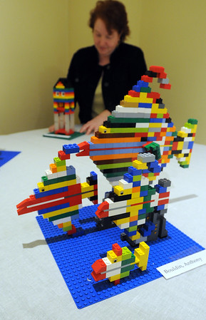 Wenham:<br /> In the foregound is an piece created by Anthony Bouldin at the LEGO art exhibit at the Wenham museum. Exhibitions curator Jane Bowers is in the background. <br /> Photo by Ken Yuszkus/The Salem News, Monday, September 10, 2012.