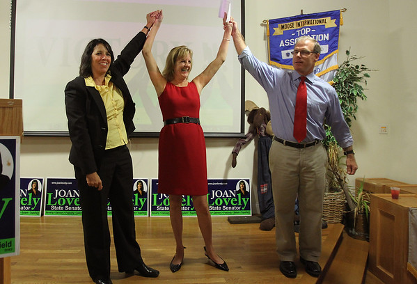 Mayor of Salem Kim Driscoll, left, and State Representative John Keenan, right, introduce Joan Lovely to a packed room of supporters at the Moose Lodge after she won the primary election and earned the Democratic Nominee for State Senate. David Le/Staff Photo