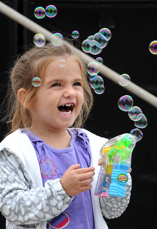 Grace Shannon, 3 1/2, of Beverly, plays with her bubble making toy at the Peabody International Festival Sunday, Sept. 9, 2012.<br /> Photo by Ken Yuszkus/The Salem News