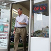 Senator Scott Brown leaves Brown's of Beverly Bicycles, on Cabot Street, after a visit on Friday afternoon. David Le/Staff Photo