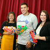 Boston Bruins forward Milan Lucic, center, stands with Violetta Powers, left, Principal of Riverside Elementary School in Danvers, and Rebecca Hutchings, right, Branch Manager of the Danvers NMTW Credit Union, holding school supplies donated to the school. David Le/Staff Photo
