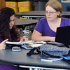 "Hamilton:<br /> Wearing purple are juniors Hannah Malatzky, left, and Devin Hoyle who are working on their school work together. Almost everyone at Hamilton-Wenham High School was wearing purple Friday. It's ""Purple for Pam"" in support of the family of Hamilton resident Pamela Wells, one of the two women who were killed in an accident while participating in a bicycle event in NH last weekend.<br /> Photo by Ken Yuszkus, The Salem News, Friday, September 27, 2013."