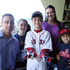 Boston: Gloucester resident Jacoby Catanzaro, 9, center, proudly shows off batting gloves given to him by Boston Red Sox center fielder Jacoby Ellsbury, surrounded by his family at Fenway Park on Sunday morning. From left are, his father David Catanzaro, sister Vidriana, 13, Jacoby, mother Heather and younger brother Nicolias, 4. David Le/Salem News