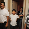 Danvers:<br /> From left, Roberto Pacheco, his son Roberto Pacheco , his daughter Isaura Pacheco, and wife Angela Suriel stand in the upstairs hallway of their home which is half of the duplex that Habitat for Humanity - North Shore completed in Danversport at 26 Mill Street.<br /> Photo by Ken Yuszkus, The Salem News, Wednesday, September 18, 2013.