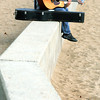 Beverly:<br /> Tony Burkett plays his guitar while seated on the seawall at Dane Street Beach in Beverly.<br /> Photo by Ken Yuszkus, The Salem News, Friday, September 27, 2013.