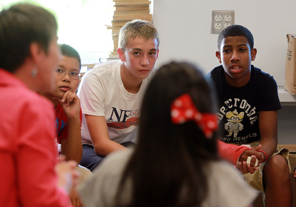 Salem: From left, Saltonstall School 7th and 8th graders Jonah Algarin, Quinn Gallant-Barrett, and Saulo Santa, listen closely to their teacher Susan Brown, on the first day of school on Wednesday afternoon. David Le/Salem News