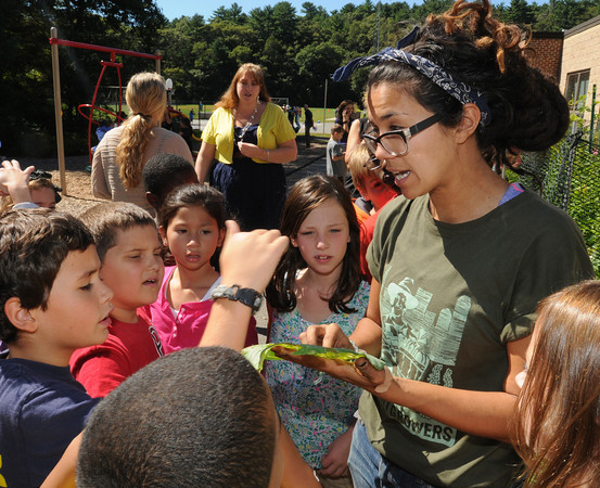 """Beverly:<br /> Leilani Mroczkowski, right, of Green City Growers speaks about a bug eaten cabbage leaf while students of the 3rd grade class at the Centerville School listens. As part of the """"Be Healthy Beverly"""" initiative, the Greater Beverly YMCA, Beverly Public Schools and horticultural professionals from Green City Growers of Somerville, Mass., showcased a new pioneering program that teaches kids how to grow their own vegetable garden. <br /> Photo by Ken Yuszkus, The Salem News, Thursday, September 19, 2013."""