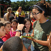 "Beverly:<br /> Leilani Mroczkowski, right, of Green City Growers speaks about a bug eaten cabbage leaf while students of the 3rd grade class at the Centerville School listens. As part of the ""Be Healthy Beverly"" initiative, the Greater Beverly YMCA, Beverly Public Schools and horticultural professionals from Green City Growers of Somerville, Mass., showcased a new pioneering program that teaches kids how to grow their own vegetable garden. <br /> Photo by Ken Yuszkus, The Salem News, Thursday, September 19, 2013."