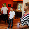 Danvers:<br /> From left, Roberto Pacheco, his son Roberto, and wife Angela Suriel stand in their home which is half of the duplex that Habitat for Humanity - North Shore completed in Danversport at 26 Mill Street.<br /> Photo by Ken Yuszkus, The Salem News, Wednesday, September 18, 2013.