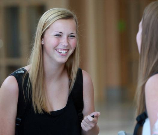 Danvers: Danvers High School senior Kaitlyn Bates talks with her friends in the front hall of the new wing of Danvers High School on Wednesday afternoon. David Le/Salem News