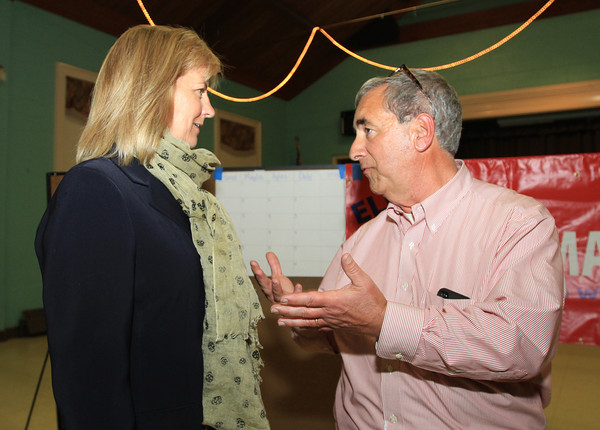 Beverly: Senator Joan Lovely, left, talks with Beverly Mayor Candidate Wes Slate, right, after Slate and Mike Cahill won the preliminary election on Tuesday evening. David Le/Salem News