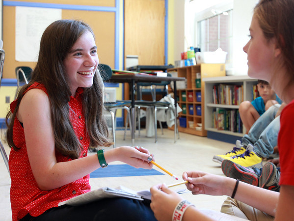 Salem: Saltonstall School eighth graders Kit Luster, left, and Neva Payson, right, talk about a summer reading assignment on the first day in the reopened and renovated school on Wednesday afternoon. David Le/Salem News