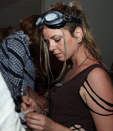 "Salem: Sarah Loscutoff, of Beverly, sews a part of a Steampunk bracelet during the PEM PM's ""80 Days: A Steampunk Celebration"" on Thursday evening. David Le/Salem News"