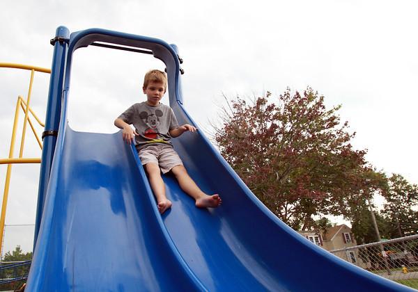 Salem: Six-year-old Jack Manninen, of Salem, flies down a slide at William Furlong Park in Salem on Tuesday afternoon. David Le/Salem News