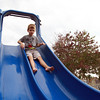 Salem: Six-year-old Jack Manninen, of Salem, flies down a slide at William Furlong Park in Salem on Tuesday afternoon. David Le/Salem News