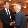 Beverly: Beverly Mayoral Candidate Mike Cahill, left, shakes hands with Beverly resident Jim Rice, on Tuesday evening. David Le/Salem News